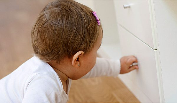Baby opening a drawer