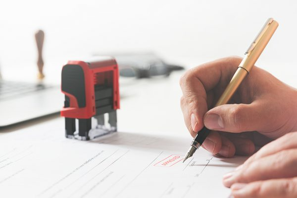 Worker using ink stamps for documents